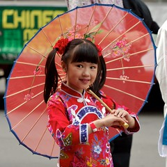 Chinese New Year (yewenyi) Tags: street red ny girl smile festival umbrella asian costume community child dress traditional sydney silk australia chinesenewyear newyear parade clothes celebration event cny creativecommons nsw newsouthwales cbd ponytail  aus syd 2008 lunarnewyear centralbusinessdistrict pc2000 springfestival  cheongsam oceania  lny  auspctagged  cnyparade  yearoftherat cny2008 cny08 6   6th cnysydney2008 agrariancalendarnewyear
