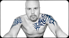Blue Tattooed (CWhatPhotos) Tags: olympus epl1 elp1 four thirds digital camera 1442mm view photo photos pics picture pictures pic image images foto fotos that have with which contain monochrome self portrait black white me cwhatphotos tattoo tattoos tattoed inked tribal tattooed ink body art upper arm shoulder arms chest blue eyes eye flickr
