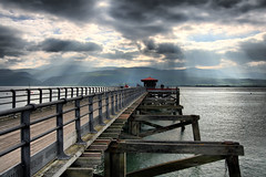 Pier light (abstract_effects) Tags: light sea cloud mountains pier mood oct rays wfc 2007 northwales blueribbonwinner gogleddcymru abigfave beaumarissky