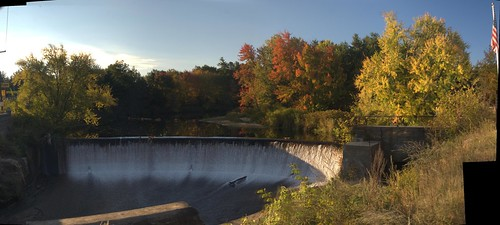 Panorama of Merrimack Dam with autumn foliage