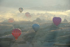 Light, shadows, mist and balloons. (BurgundyMT) Tags: travel copyright digital turkey photography michael photo nikon bravo flickr image turkiye picture images photograph hotairballoon cappadocia toh d80 fotogezgin singaporephotographer burgundymt michaeltoh michaeltohcopyright