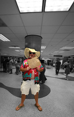 Welcome to America, Miami Airport (s0ulsurfing) Tags: travel wild usa blur travelling hat sunglasses sign america photoshop cutout fun toy crazy airport focus friend funny dof florida miami unitedstatesofamerica nick wide perspective january meeting wideangle manipulation ps dude american flipflops tropical destination walls arrival 2008 fla greeting tropics hawaiianshirt fearloathing gringo arrivals minature southflorida selectivecolour 10mm miamiairport sigma1020 arrivalhall faketiltshift gjp s0ulsurfing
