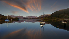 Sailboat Reflections (Giovanni Giannandrea) Tags: lochleven lochliobhann sea loch scotland lochlyon glencoe acharnaich highlands ballachulish kinlochleven sailboat redsky tighphurist
