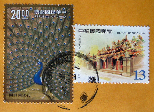 Chinese stamps + peacock