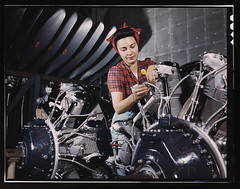 Woman working on an airplane motor at North American Aviation, Inc., plant in Calif.  (LOC) (The Library of Congress) Tags: california red woman usa june lady america vintage hair airplane us women war industrial factory rosietheriveter aircraft aviation military unitedstatesofamerica wwii monalisa working engine machine makeup slidefilm worldwarii 1940s transparency ww2 4x5 lf worker motor libraryofcongress 1942 bandana plaid tough hairstyles largeformat worldwar2 radial inglewood wartime transparencies aircooled womenatwork northamerican civilians naa radialengine inglewoodca northamericanaviation xmlns:dc=httppurlorgdcelements11 yellowbutton dc:identifier=httphdllocgovlocpnpfsac1a35287 alfredtpalmer june1942 alfredpalmer r260029wrightcyclone