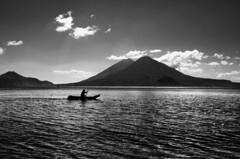 Lago Atitlán (anita gt) Tags: bw lake man blanco lago person persona guatemala negro atitlán bn volcanoes hombre volcanes guate cayuco flickrgt