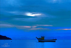 blue (_Paula AnDDrade) Tags: blue sea brazil sky beach beautiful brasil clouds boat twilight explore mariscal diamondclassphotographer imfeelingblue betterthangood feelfreetocrytome