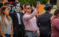 2016 - Mexico - Morelia - Selfie (Ted's photos - Returns Mid May) Tags: 2016 cropped mexico michoacán morelia moreliamichoacán nikon nikonfx tedmcgrath tedsphotos tedsphotosmexico tedsphotosmexicomorelia vignetting handsome handsomeboy boy male crowd people denim denimjeans selfie sunglasses reflection bowtie hat belt beltbuckle longhair lips cellphone bokeh facepaint