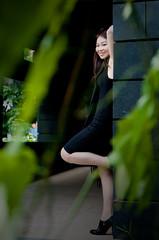Between Leaves (Mario Wibowo, ARPS) Tags: portrait green leaves fashion model nikon 85mm lasalle framing f18 kyoko d300