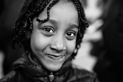 A shy and beautiful missy (Giulio Magnifico) Tags: woman eye smile closeup lady children happy child expression young longhair citylife streetphotography streetportrait shy sharp gaze glance udine nikond800e sigma35mmf14dghsm