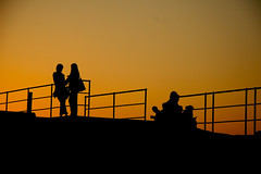 silhouetted people (Barry McGrath) Tags: ireland sunset sky people dublin orange silhouette canon eos dun 30d laoghaire canoneos30d mywinners aplusphoto barrymcg bazzymcg