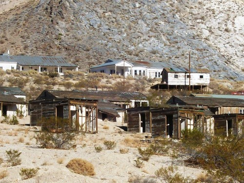 Abandoned mine buildings (Anaconda Copper Mining Company) in the bright sunlight on the outskirts of Darwin, a ghost town outside Death Valley, CA - darwin08x