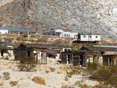 Abandoned mine buildings (Anaconda Copper Mining Company) in the bright sunlight on the outskirts of Darwin, a ghost town outside Death Valley, CA (darwin08xy) (mlhradio) Tags: california abandoned desert darwin ghosttown deathvalley miningtown deathvalleynationalpark mountophir inyocounty highway190 cosomountains mlhradio anacondacopperminingcompany anacondacopper olanchadarwinroad statehighway190