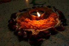 Diya (parvation) Tags: flowers orange lamp flame heartshaped kolam diya pookolam theindiatree