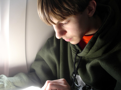 John doing homework at 37,000 feet
