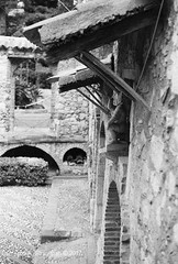 CNV00025s (Cameron A. Straughan) Tags: travel tourism eccentric quirky surreal odd architecture street history angles lines culture 35mm exposures film developing 400 iso real photography traditional photographs fuji stx2 camera processing tamron zoom lens 35 mm manual black white photos classic old school ilford taormina hill mountains sicily mount etna active volcano teatro antico di ancient greco¬roman godfather francis ford coppola italy