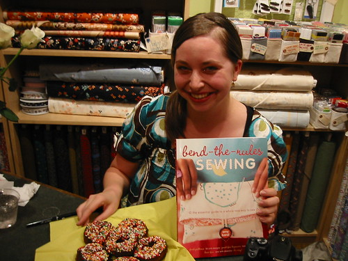 Amy and a plate of donuts at her lovely book party!