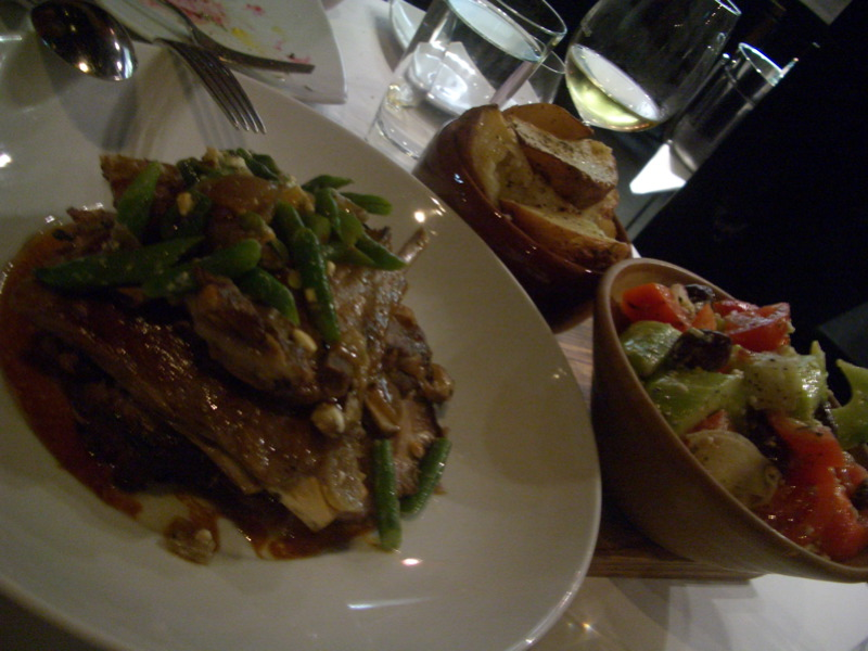 Lamb from with spit roast with white bean skordalia, beans, fetta, Greek salad and potatoes