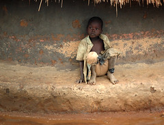 Daydreaming in the Rain (JakeBrewer) Tags: africa water children clothes huts sewage uganda awareness 2007 ngos northernuganda idpcamps africamyafrica
