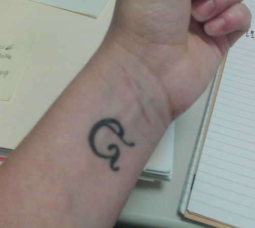 ampersand wrist tattoo