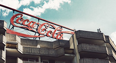 thirsty? (Crazy Ivory) Tags: lighting camera city windows light red urban cloud house blur berlin rot art public colors architecture backlight clouds contrast photoshop canon buildings germany advertising deutschland eos licht amazing cool colorful europe neon view bokeh candid sommer ad dream coke blurred east cocacola dslr 70300mm eastern sonne tamron70300 fav10 tamron70300mm 400d canoneos400d canoneos400dcanon gettygermanyq2 gettygermanyq3 gettygermanyq4