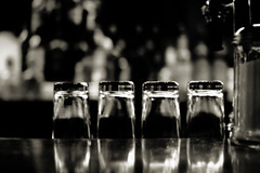 The four horsemen (digitalgopher) Tags: bw reflection bar table glasses blackwhite nikon bokeh tosca 30mm magiclight sigmalens nikond40 sothisisbetter illdeleteoneofthetwosoon lookslikethebwisthewaytogo