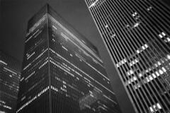 6th Avenue, NYC (Adam Garelick) Tags: leica nyc newyorkcity blackandwhite film monochrome night buildings skyscrapers manhattan grainy 3200 m7