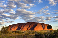 Monolith (woolyboy) Tags: trees mountain rock lowlight desert australia sacred uluru aboriginal sunsetlight northernterritory ayresrock woolyboy