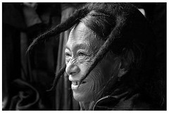 The Old Woman with a sheep wool headgear (Lemyao Shimray) Tags: blackandwhite wool smile women peace sheep oldwoman ethnic wrinkles soe globalvillage nationalgeographic naga headgear northeastindia  indigenouse mywinnerstrophy theexhibit aplusphoto flickrhearts amazingshots 5bangs diamondclassphotographer megashot lunarvillage flickrextraordinaraycapture splendidflickyphotodistrict hiddenworldbeyondthecloud