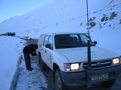 Mobile 9 - Jabar Amiri attaching snow chains