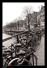 Amsterdam (Xavier Donat) Tags: old city bridge winter bw netherlands amsterdam bicycle capital d300 friendlychallenges