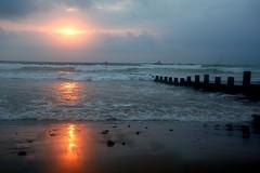 Sunrise over the North Sea, Aberdeen (iancowe) Tags: morning sea reflection beach clouds sunrise scotland wooden sand waves north wave aberdeen esplanade promenade groyne groynes