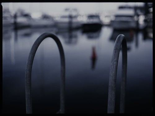 morning 120 film water docks mediumformat reflections river boats fuji dof bokeh steel newquay australia melbourne slide victoria yarra docklands ladder yachts 6x45 e6 provia100f urbanlandscape wideopen mamiya645protl fujichromeprovia100frdpiii 80mmf19sekorc
