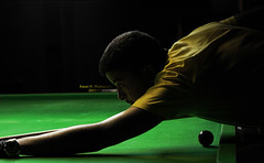 Anticipation (Rayan M.) Tags: portrait slr pool field yellow digital poster photography design focus dof darkness sony m professional saudi ready shooting anticipation dslr billiard depth snooker lense 70mm rayan    a350