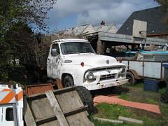 Ford in a dumpy yard