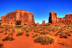 Monument Valley (Thad Roan - Bridgepix) Tags: blue red arizona sky mountains tree landscape utah rocks landmark soil geology monumentvalley sagebrush buttes 200711