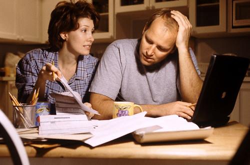 people looking over finances