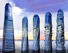 Dubai City Revolving Towers (webjunky80) Tags: pictures park city beach sports weather marina buildings islands amusement al dubai waterfront images palm cranes arab hotels roads burj
