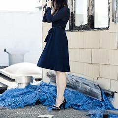 27 :: 31 (sweethardt) Tags: blue woman selfportrait window female peeling paint photographer dress navy brunette stilettos tarp louboutin fullyfunctionalpropcameraasahipentaxspotmatic windismagical