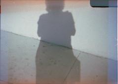 My shadow (QsySue) Tags: shadow wall toy grey 110 toycamera sidewalk spy santaana spycamera 110film minicamera ansco50