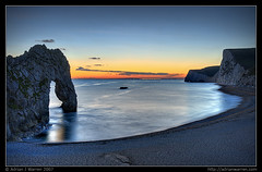 Jurassic arc (AdrianWarren) Tags: uk longexposure greatbritain sunset sea england night landscape coast topf50 topf75 cliffs unesco dorset getty soe canonef1740mmf4lusm hdr 2007 worldheritage durdledoor jurassiccoast 3xp photomatix itblog durdledor mywinners abigfave canoneos400d canondigitalrebelxti canoneos400ddigital anawesomeshot diamondclassphotographer flickrdiamond megashot thegoldendreams 19october2007