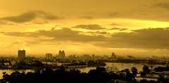 HCMC Skyline (... Arjun) Tags: bw 15fav panorama monochrome skyline sepia 1025fav 510fav nikon asia 100v10f panoramic vietnam 2550fav 500v50f 50100fav d200 toned saigon hochiminhcity tinted hcmc 2007 indochine indochina saigonriver 18200mmf3556g bluelist anawesomeshot thanhdaisland