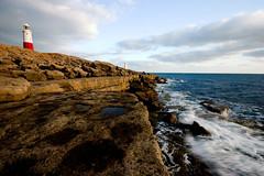 coastal (*Hairbear) Tags: november blue sunset sky lighthouse portland evening coast bill rocks surf sunny dorset coastline 2007 sigma1020mm