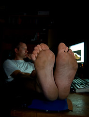 Gotta Lotta Sole (Craig Jewell Photography) Tags: lighting selfportrait man male feet computer dark table foot office keyboard toes flickr dof desk bare screen dirty monitor craig barefeet lit sole strobe strobist pentaxk10d 7daysofshooting justpentax traditionalthursday gettypick craigjewellphotography