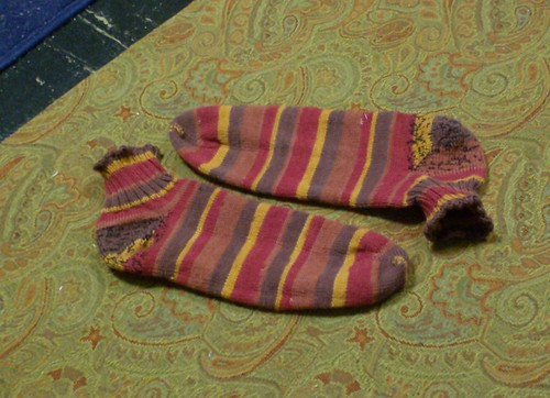 Finished pair of red and brown striped socks