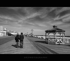 Coney Island Boardwalk (DP|Photography) Tags: blackandwhite bw sepia coneyisland blackwhite piers beaches manhattanbeach 1020mm brightonbeach wonderwheel keyspanpark beachwalk handinhand coneyislandboardwalk gravesend sigma1020mm steeplechasepark barrierislands nathansfamous denoswonderwheel astrolandpark brooklynnewyork seasidewalk newyorkbeaches riegelmannboardwalk debashispradhan dpphotography dp|photography