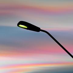 Artificial light vs nature's own illumination (Rune T) Tags: light sunset sky color nature lamp silhouette square post artificial vs rtphoto fullcutofflightfixture