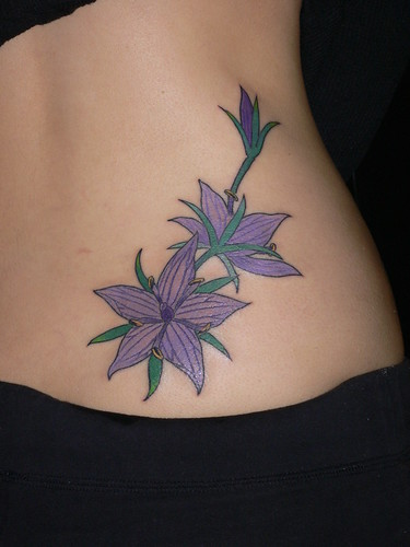 Sexy Purple Flower Tattoo on side body tattoo