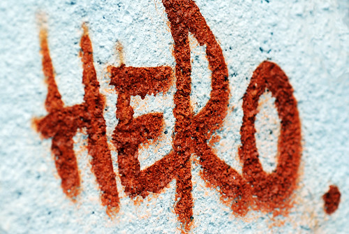 "spray painted graffiti of the word ""Hero"""