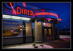 Blue Diner (Anchorage Impressions '07) (heritagefutures) Tags: nightphotography blue winter copyright snow trafficlights art cars alaska night neon traffic dusk diner retro anchorage hr benson deco dirk allrightsreserved citydiner lightstream spenard spennemann heritagefutures dirkhrspennemann heritagefuturesallrightsreserved copyrightdirkhrspennemann ausphoto